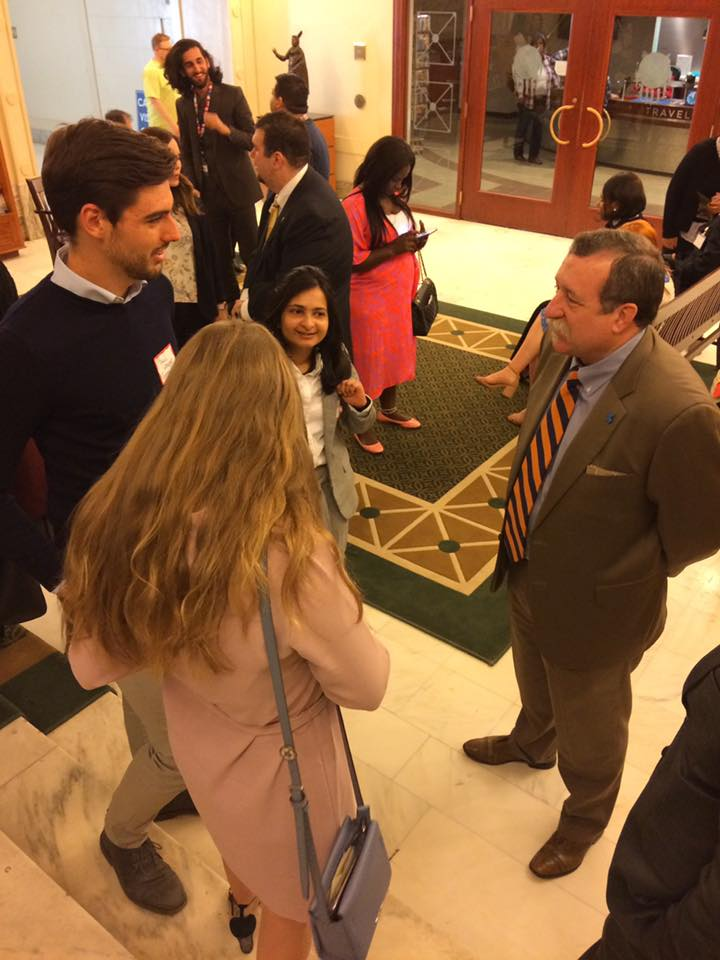 Representative Mark McBride talks with students at the Oklahoma State Capitol.